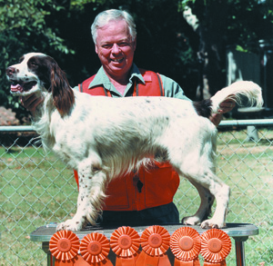 Spencer with one of his Springer Spaniels, Flick, with his six MH qualifying rosettes.