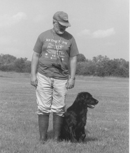 Flat-coated Retriever and handler